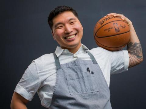 Smiling man holding a basketball