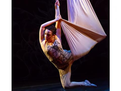 Amancay (Candal Tribe) Kugler performs aerial silk acrobatics for her circus company.
