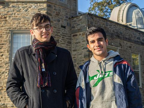 Jesse Zeldes and Sergio Montano stand in front of the on-campus observatory