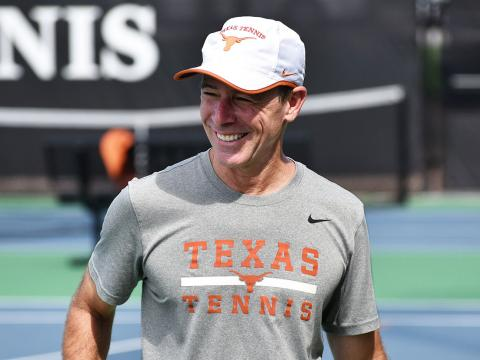 Coach Bruce Berque on the tennis courts