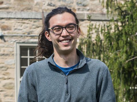 Justin Otter '19 in front of Strawbridge Observatory