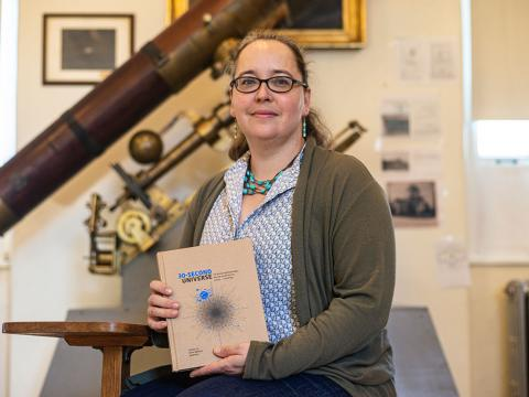 Professor Karen Masters holds a copy of her new book