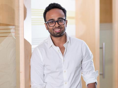 Shreyas Shibulal wears glasses and a button-down shirt and smiles for the camera