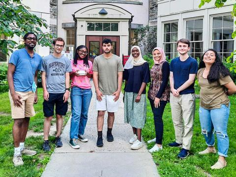 Clyde Daly (on the far right) and the seven student members of his lab this summer stand in front of the KINSC Rotunda
