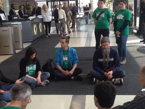 Earth Quaker members sitting in peaceful protest
