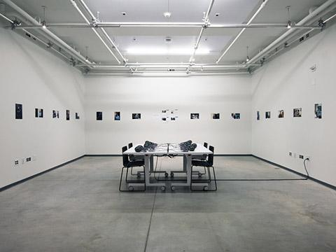 Tables loaded with listening equipment in a create space