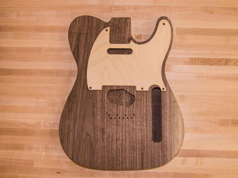Fabricated face for a guitar