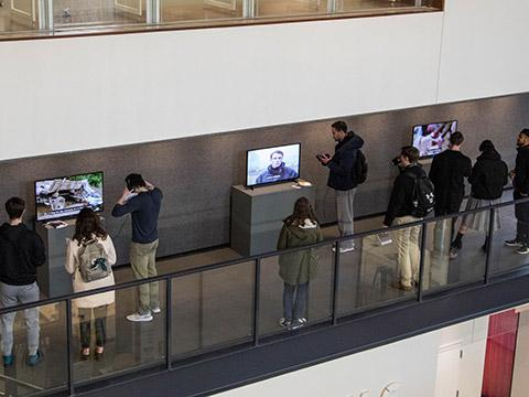 Visitors interacting with viewing stations in VCAM