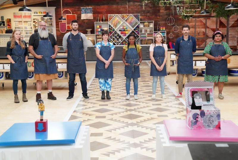 Jessie Lamworth (first from left) and seven other contestants on the set of Making It wearing the iconic denim aprons
