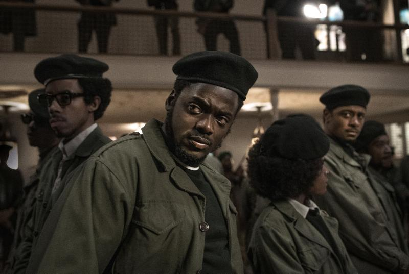 A still from Judas and the Black Messiah with Daniel Kaluuya (center), Lakeith Stanfield (far right), and other actors playing Black Panthers, wearing black berets