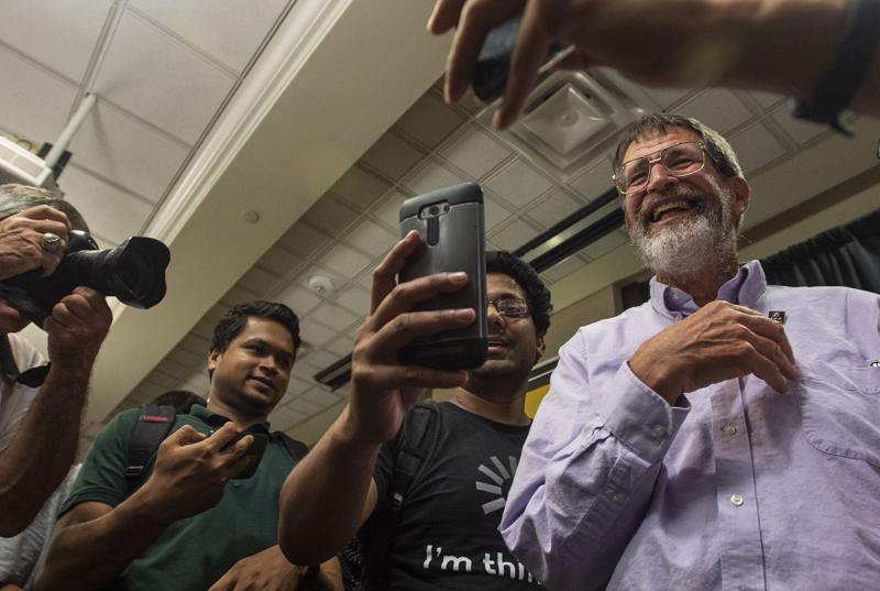 Nobel laureate George P. Smith is mobbed by selfie seekers at an event at the University of Missouri