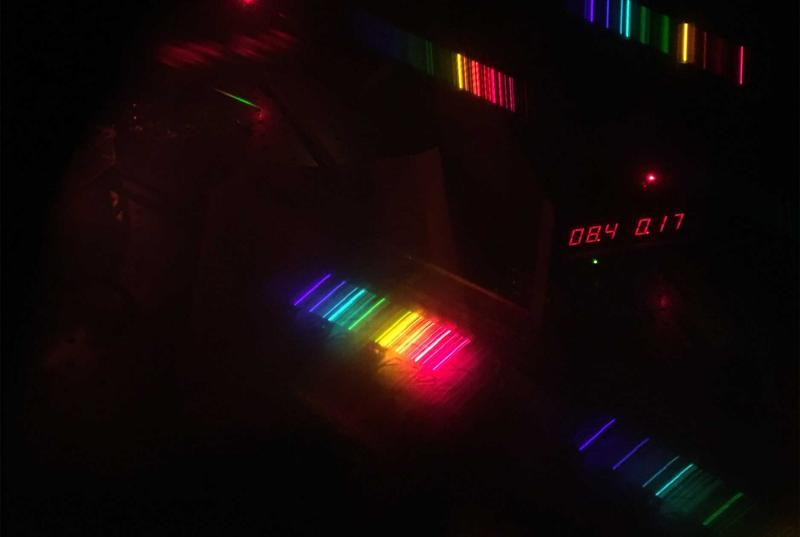 The spectral emission lines of a Helium-Neon gas sample taken using novelty pair of paper diffraction grating glasses