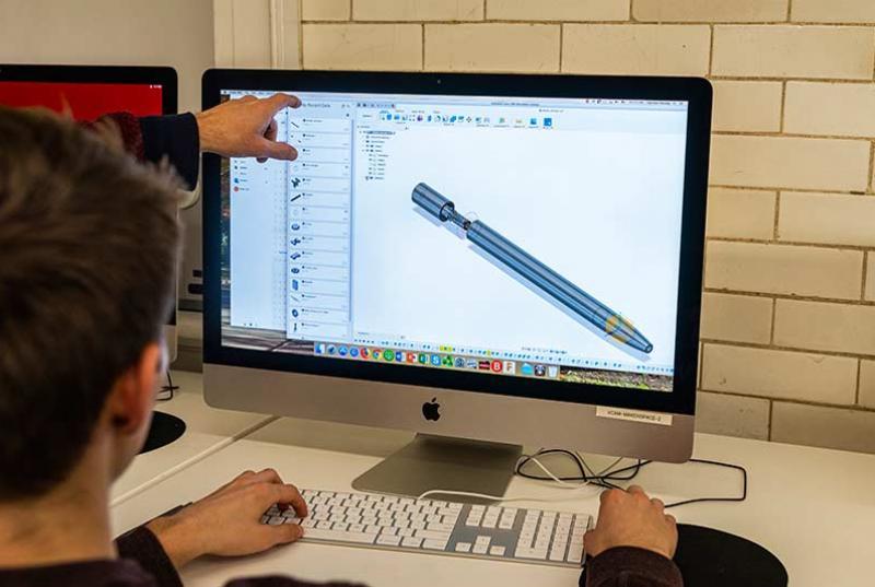 a student designs a 3D model of a pen