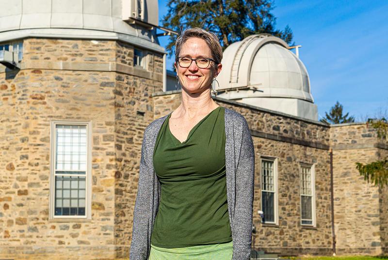 Andrea Lommen in front of Strawbridge Observatory