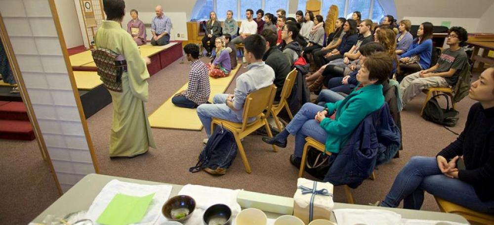 Students viewing a Japanese Tea Ceremony demonstration.