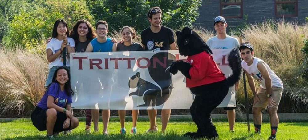 Students posing in front of Tritton Hall on Move In Day