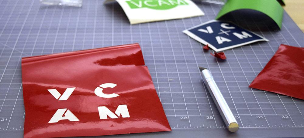 VCAM logo cut out of vinyl