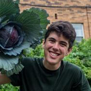 Man carrying giant head of cabbage