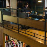 Student studying inside of Magill Library