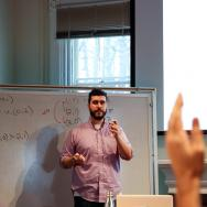 Visisting Assistant Professor of Economics Matthew Incantalupo leading a classroom discussion