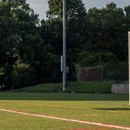 Max Krieg '19 mid-air kicking a soccer ball