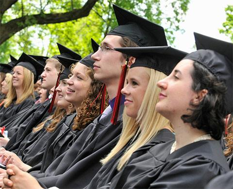 A row of students in caps and gowns on commencement day