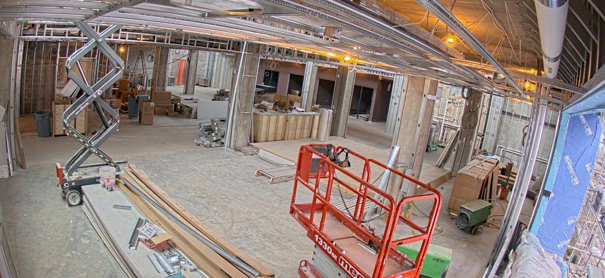 interior of the library under construction, featuring an extended cherry picker.