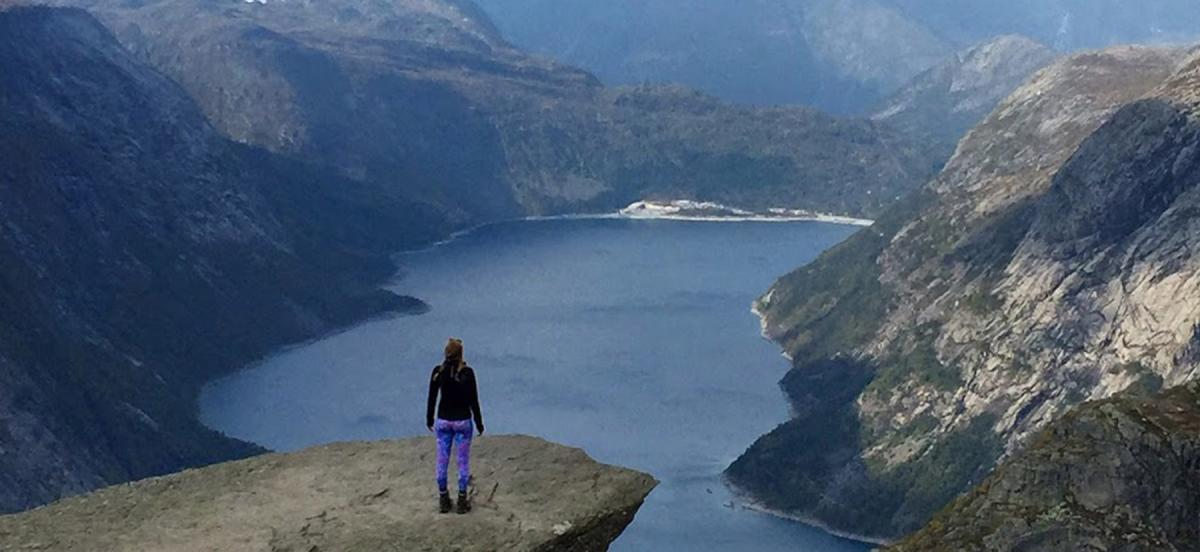 Jessie Lamworth stands on an outcropping overlooking the Hardanger Fjord