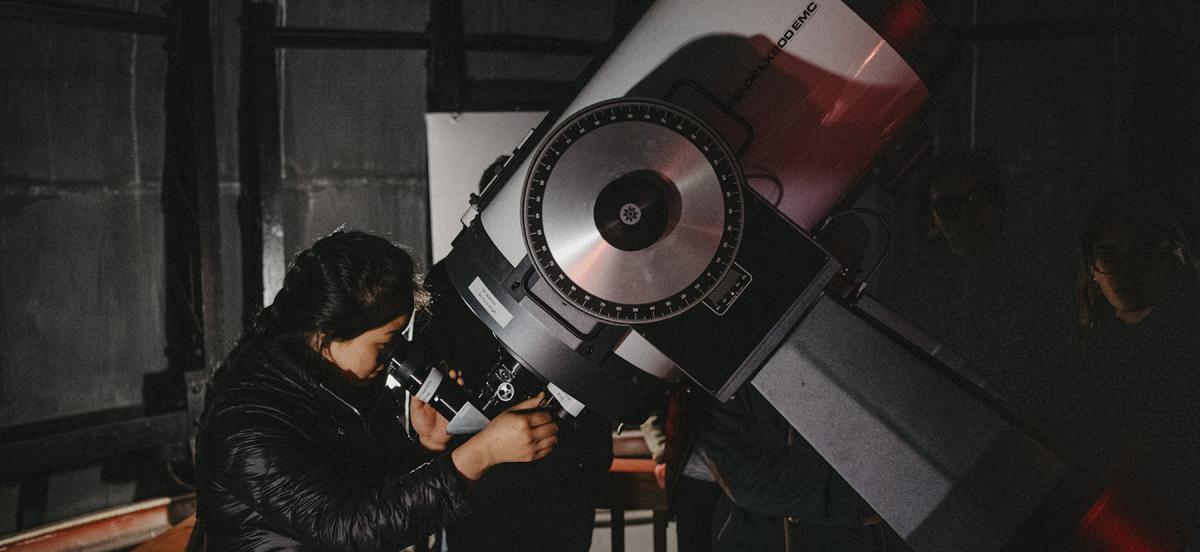 Students using a 16-inch Schmidt-Cassegrain telescope
