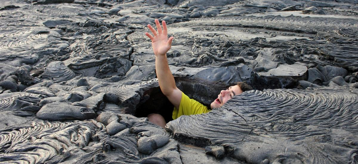 Student pretending to be caught in a lava flow