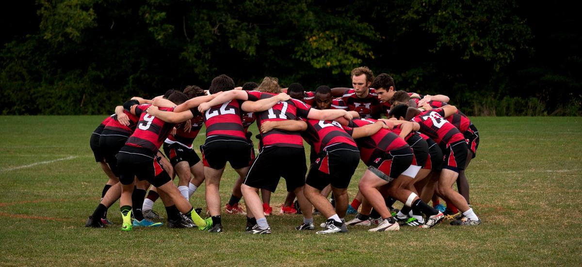 The Rugby team in a huddle.