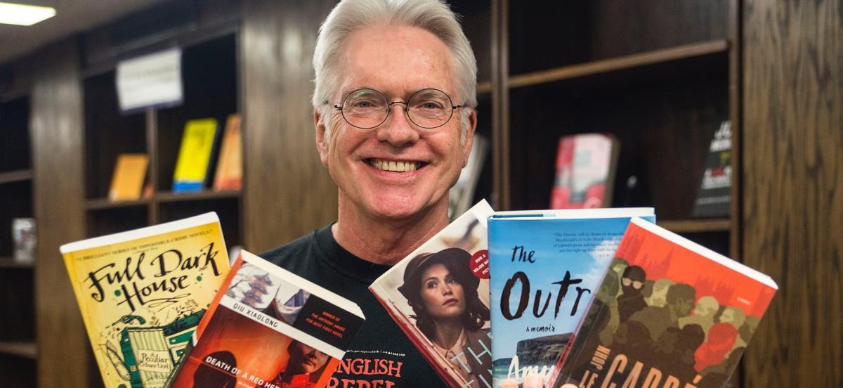 Man holding up books