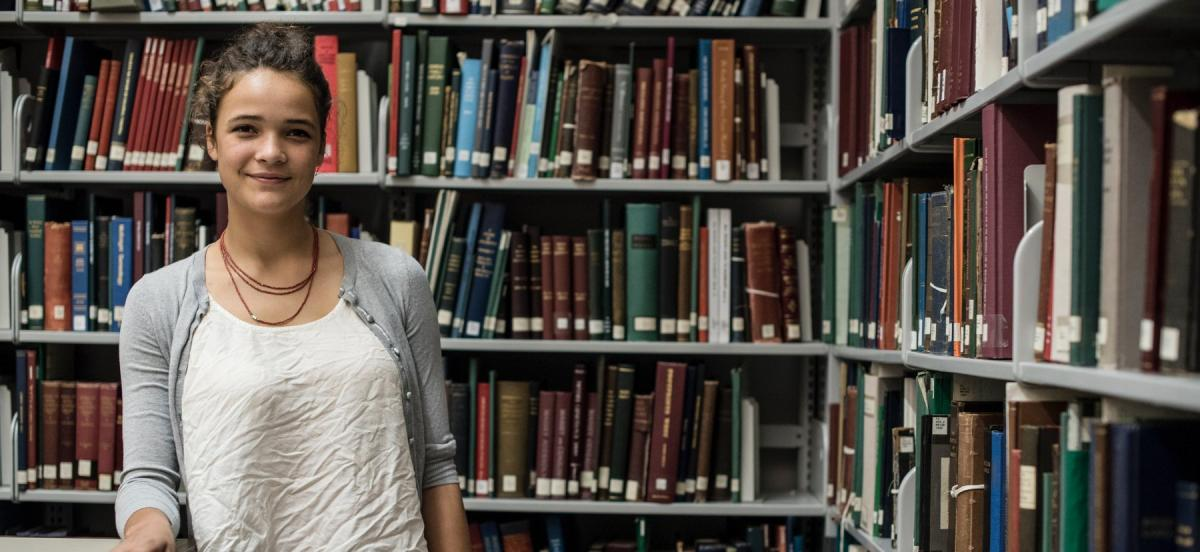 Safiyah Riddle in a library