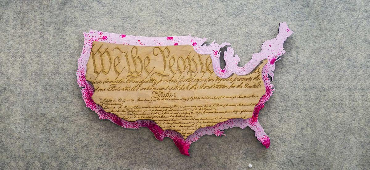 we the people etched into an outline of the united states