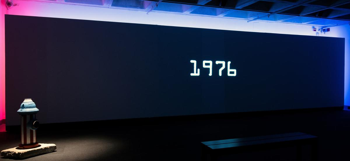 Projected image of film displaying type reading 1976