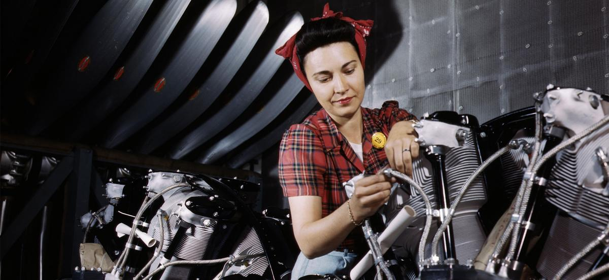 Woman works on an internal combustion engine