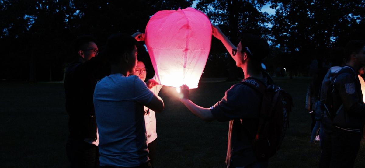 Students at night with lantern