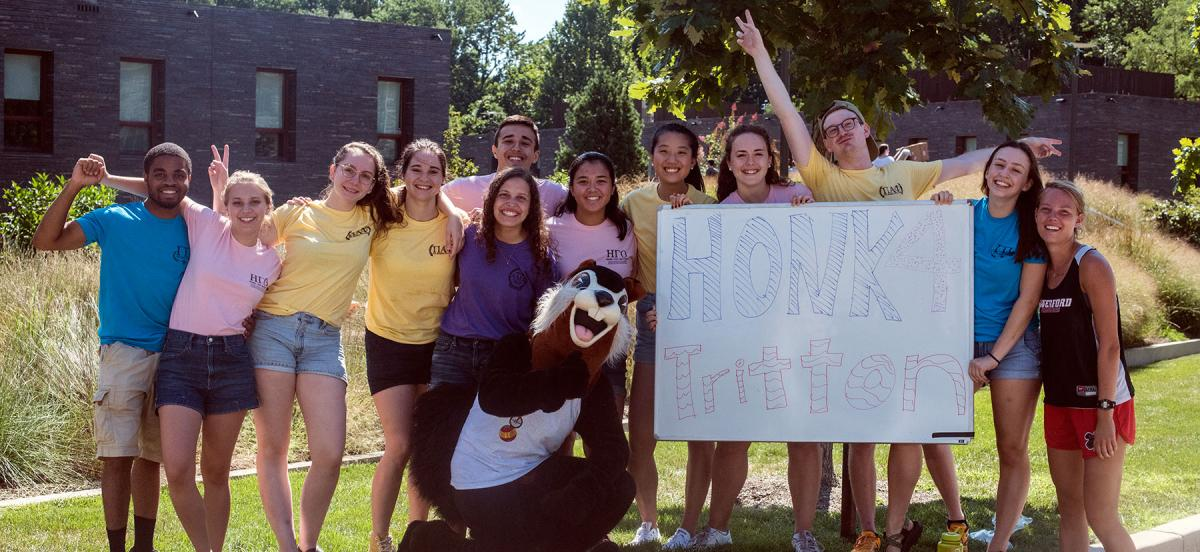 Group of students and the Black Squirrel with a Honk 4 Tritton sign
