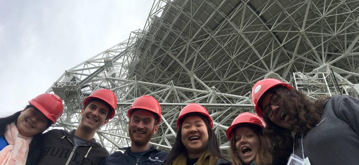 Students pose with the Green Bank Telescope in the background