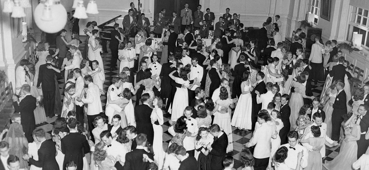 Dancers in formal attire in Founders Hall.