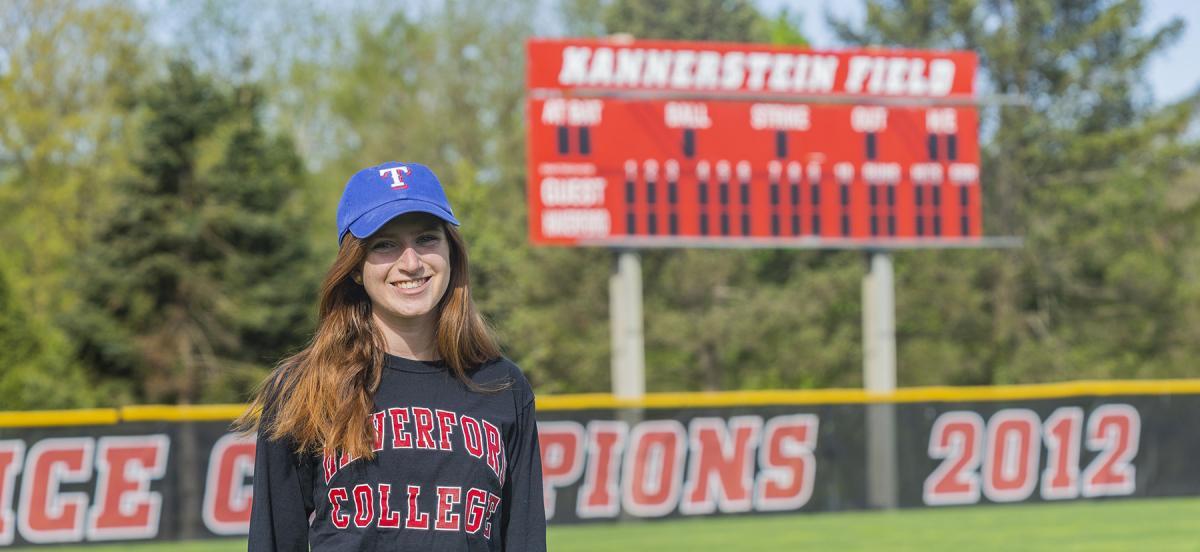 Charlotte Eisenberg on Kannerstein Field in her Texas Rangers hat