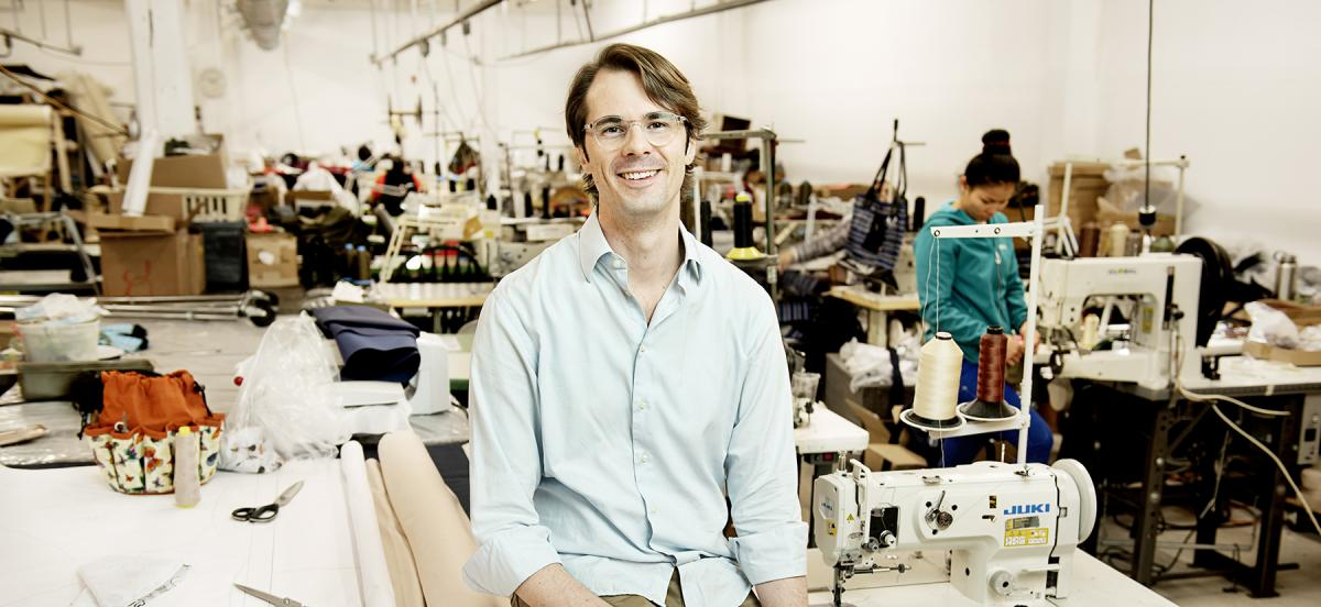 Griffin Vance in the factory where his environmentally conscious clothing line is made