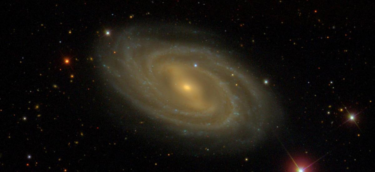 A swirling galaxy, known as Messier 109, that is around 85 million light years away in the direction of the Big Dipper.