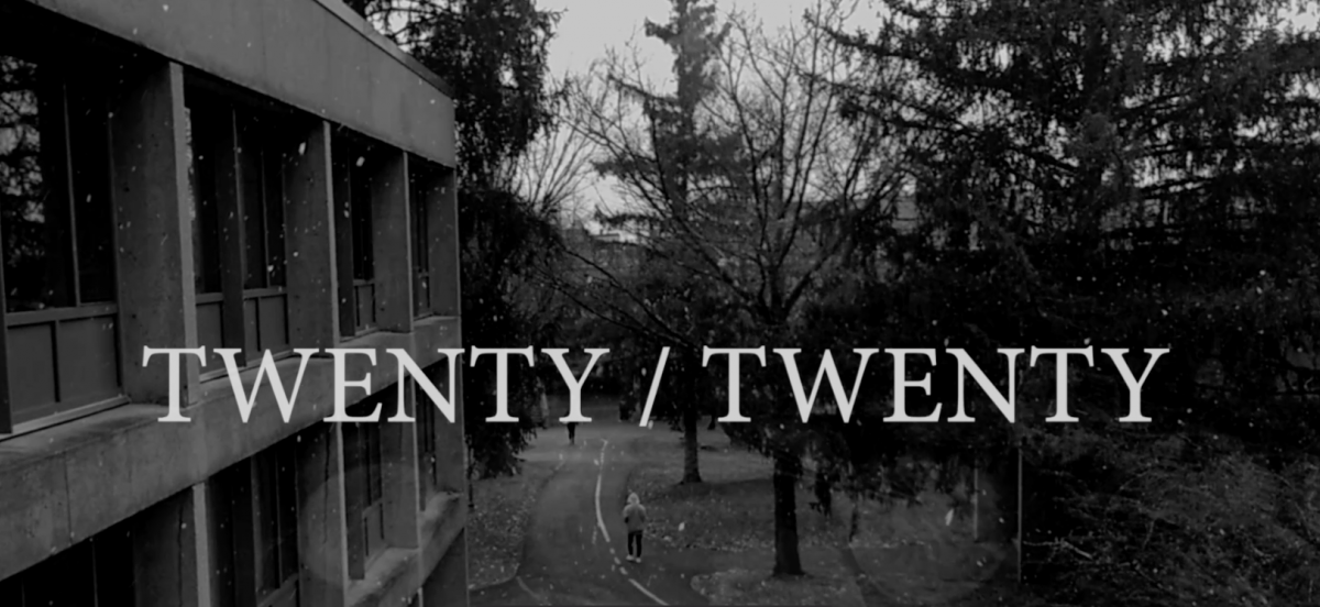 """A black-and-white photo taken from a second story window of campus as it is snowing with the words """"Twenty/Twenty"""" written on top of them"""
