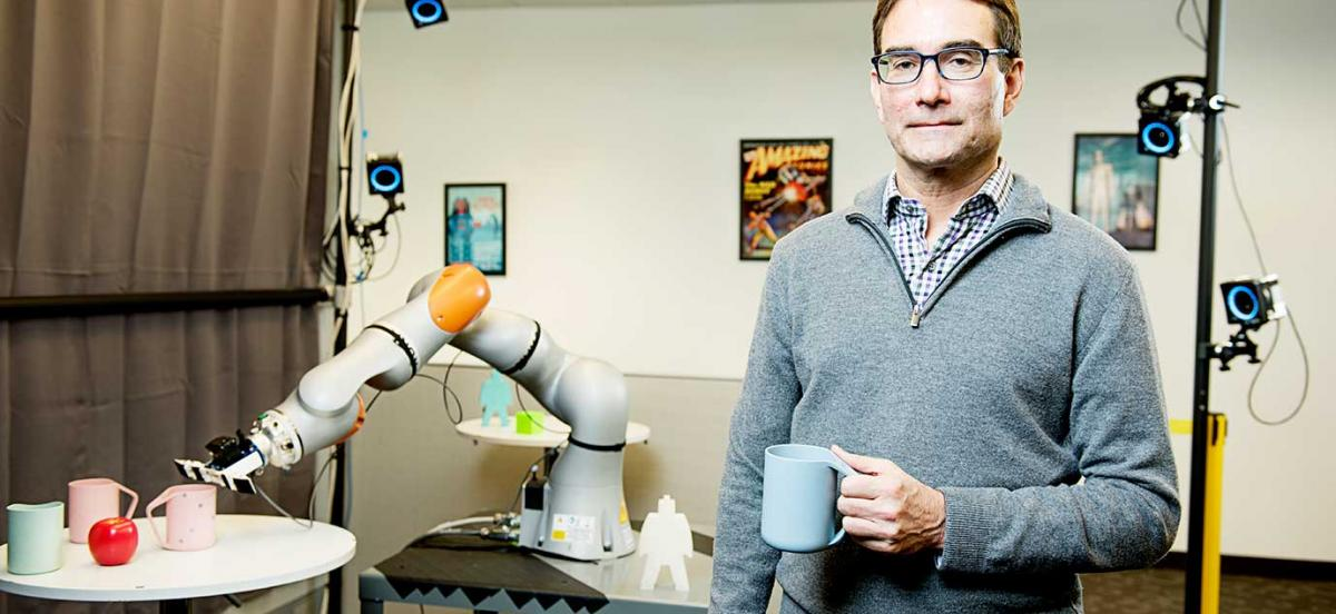 Eric Krotkov with a robotic arm