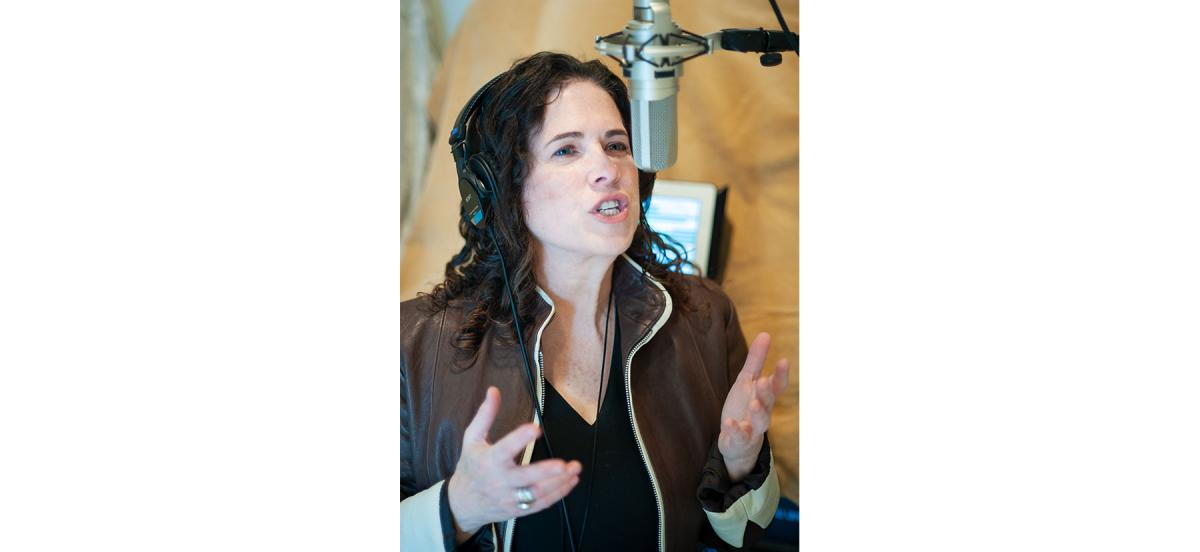 Eve Passeltiner at the microphone doing voiceover work