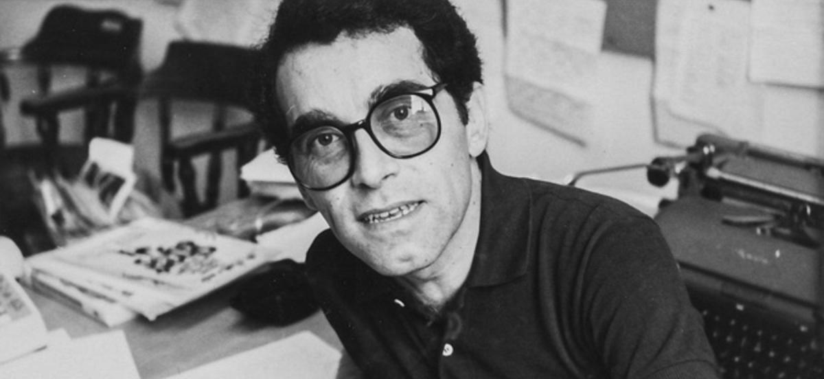 Ramon Garcia Castro sitting at a typewriter at a desk smoking
