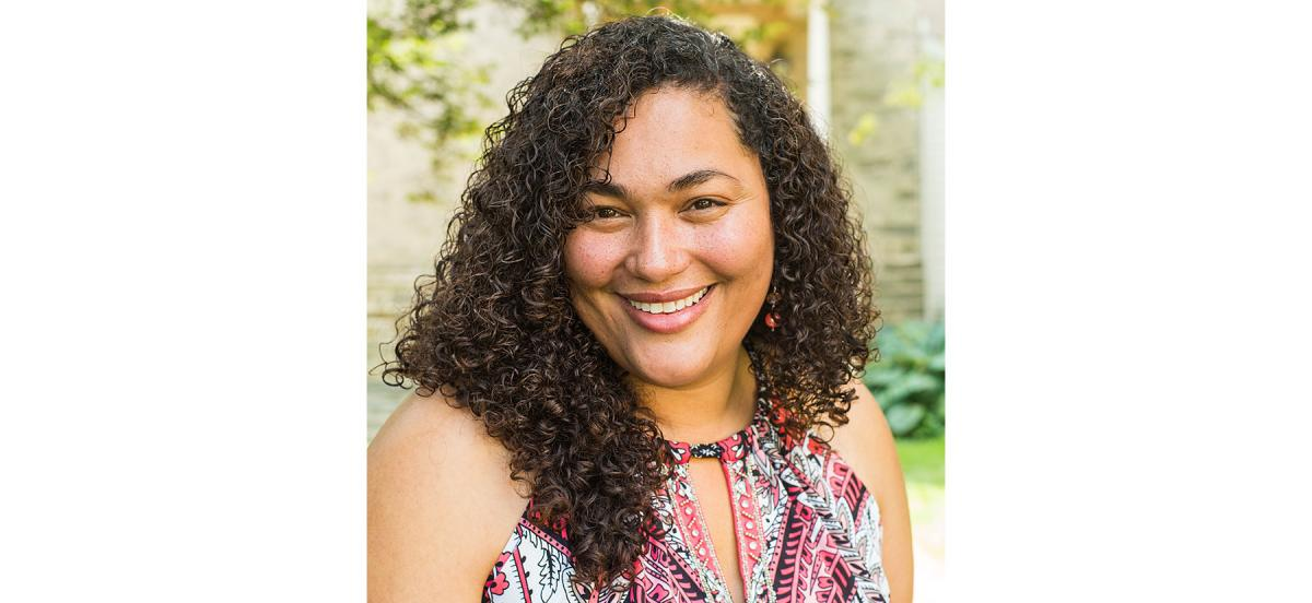A headshot of Raquel Esteves-Joyce taken outside