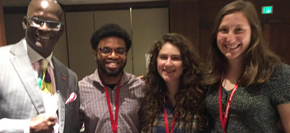 Students posing for photo at conference