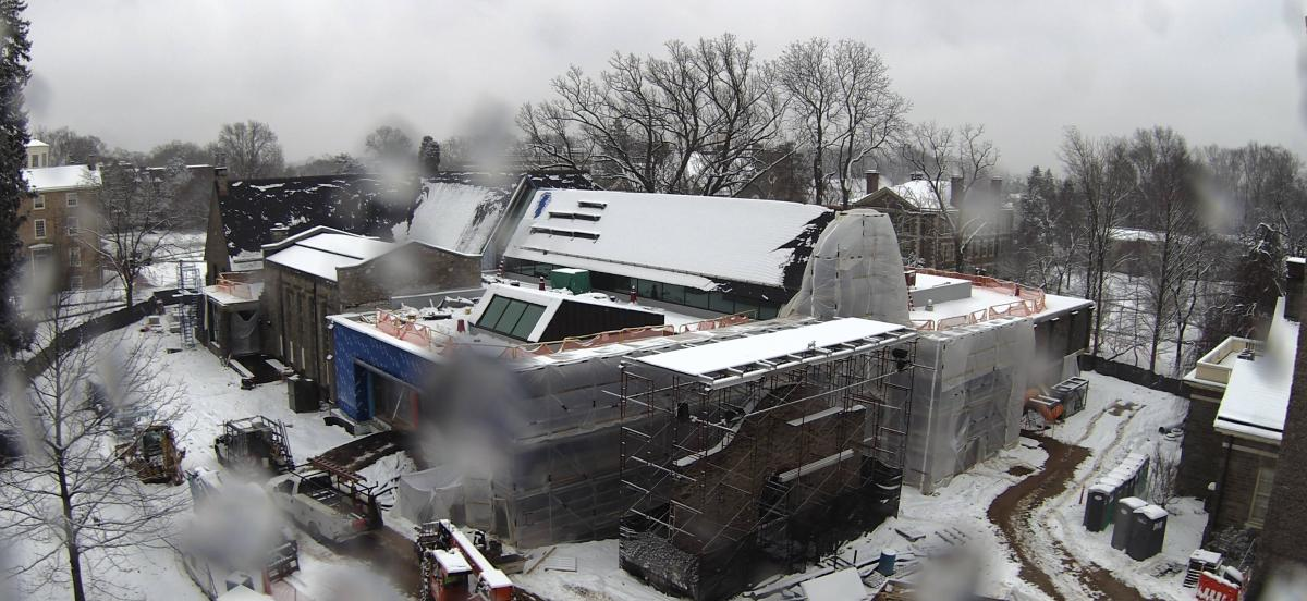 Exterior of the library under construction, covered in snow.